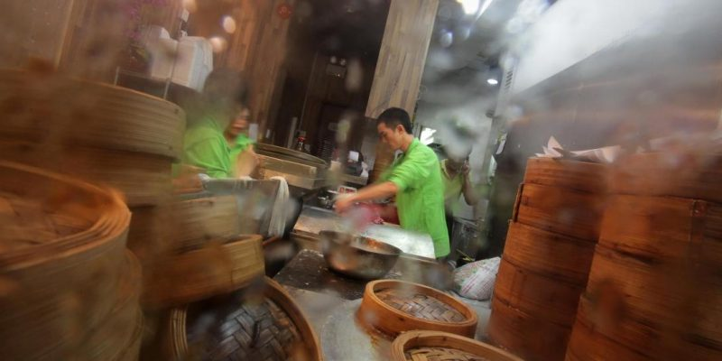 A chef prepares a rice pastry roll at th